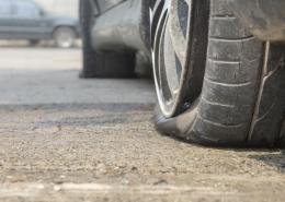 Car flat tire on road
